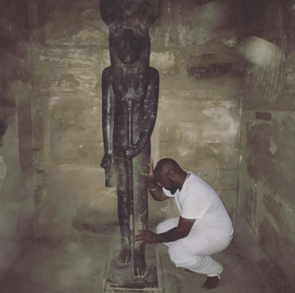 Tony at Karnak Temple with a statue of Sekhmet