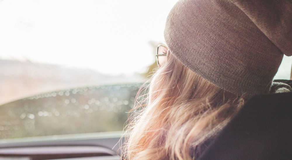 young-beautiful-blonde-girl-looking-out-of-car-window-picjumbo-com-e1467744139178.jpg