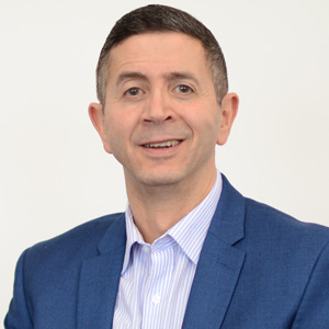 John Ghader   John reports directly to the Prima Group Board and has overall responsibility for delivering the Group's Corporate Strategy, and is accountable for Prima Group, Pierhead Housing Association, Leasowe Community Homes and Pierhead Commercial.