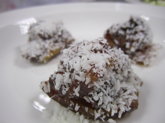 Dates stuffed with almond butter and unsweetened coconut