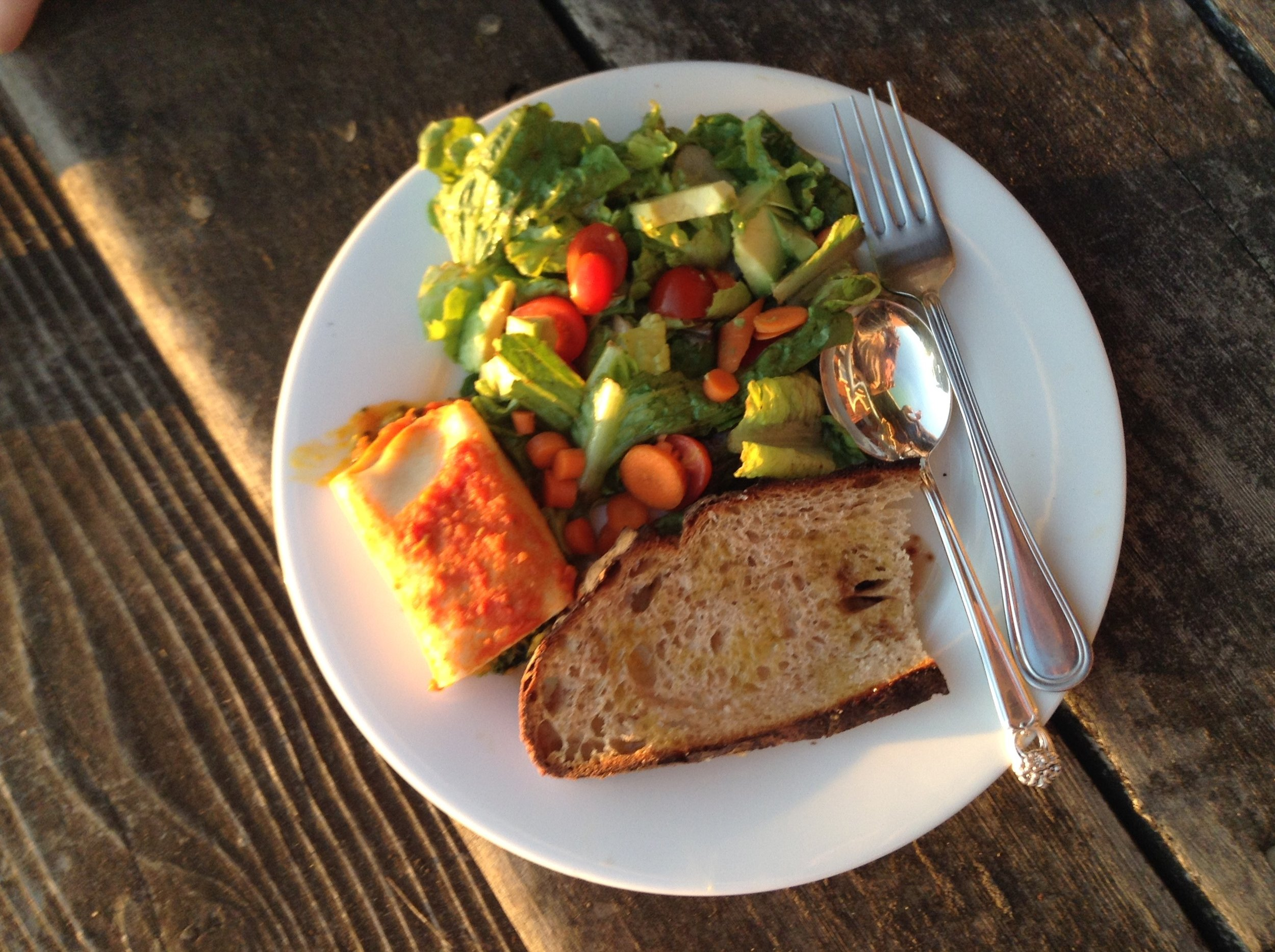 Vegetable cannelloni, green salad, and brown bread drizzled with olive oil—delicious.