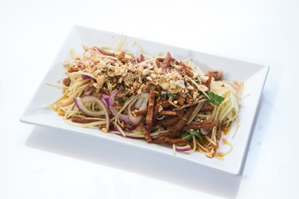 Green Papaya withBeef Jerky or Vegan Beef - Fresh shredded papaya, beef jerky, topped with fresh basil, roasted peanuts, onions, fried shallots, and soy vinaigrette sauce. (Menu Item 8)
