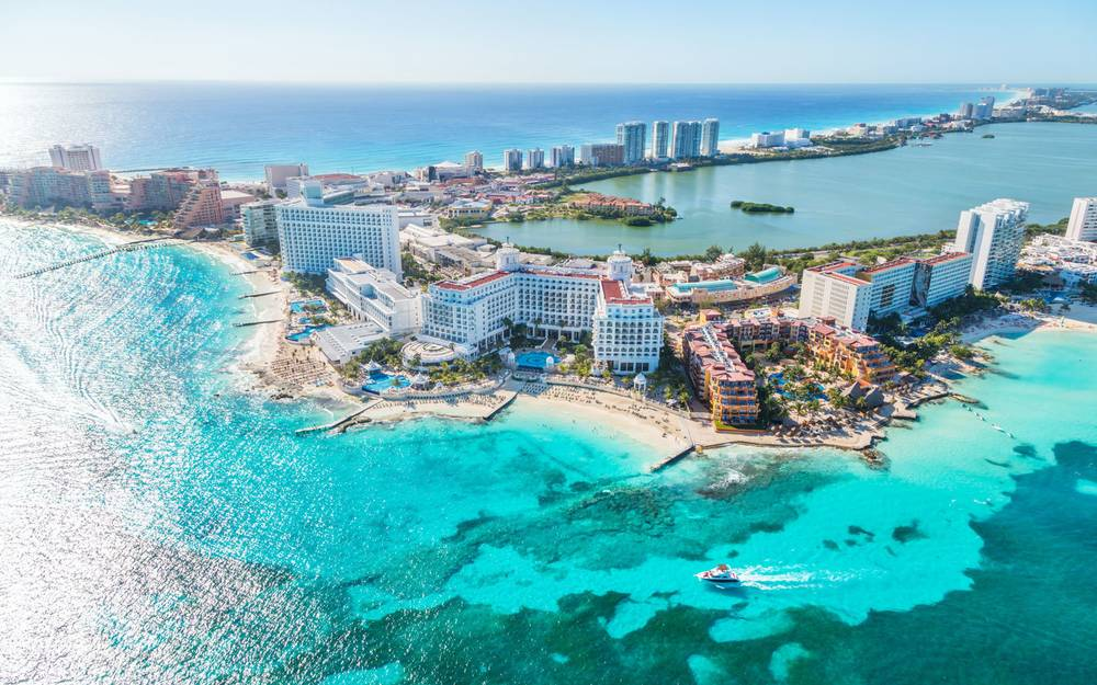 1. Cancún - Averaging at around 86°F/30°C during December, Cancun is one of the warmest places to travel to during the colder months. Known for its beautiful beaches and nightlife, it's a fun escape from the city life.__PLACES TO VISIT• Aquaworld• Delfines Beach• El Ray Ruins