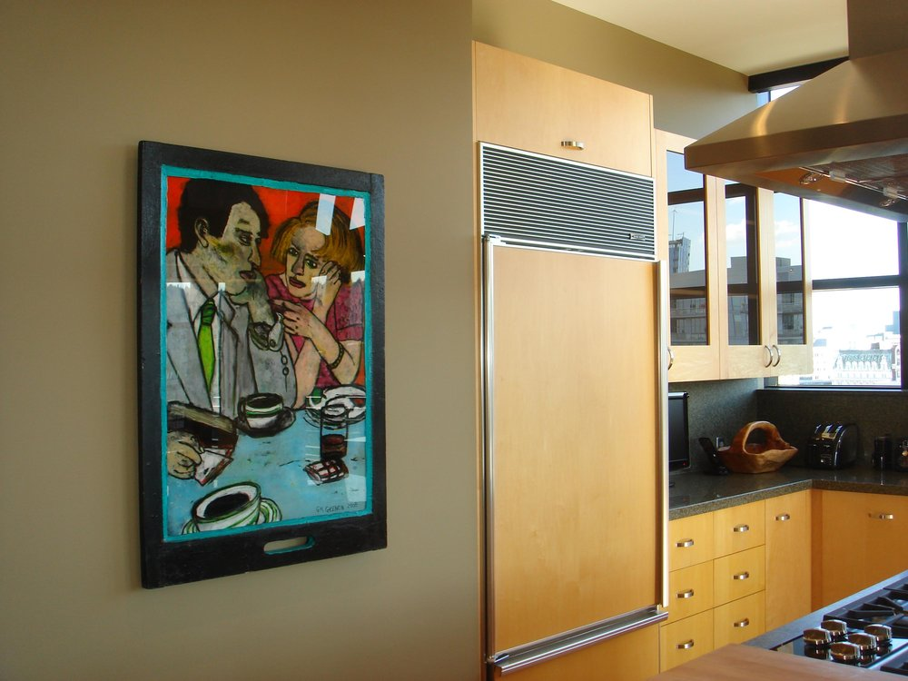 Kitchen interior with artwork on the wall