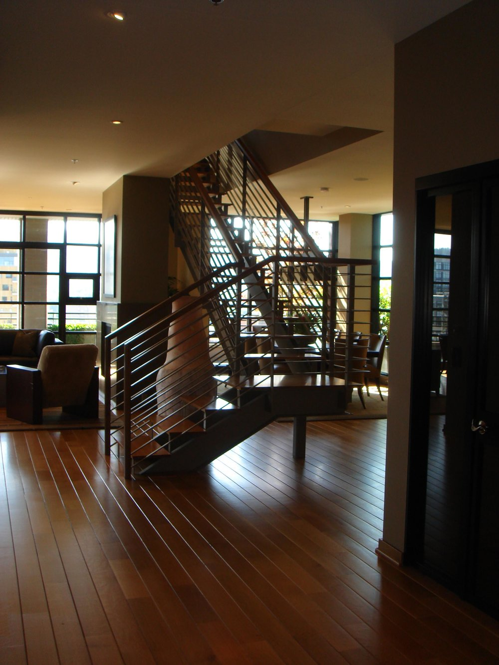 House interior with staircase and a hardwood floor