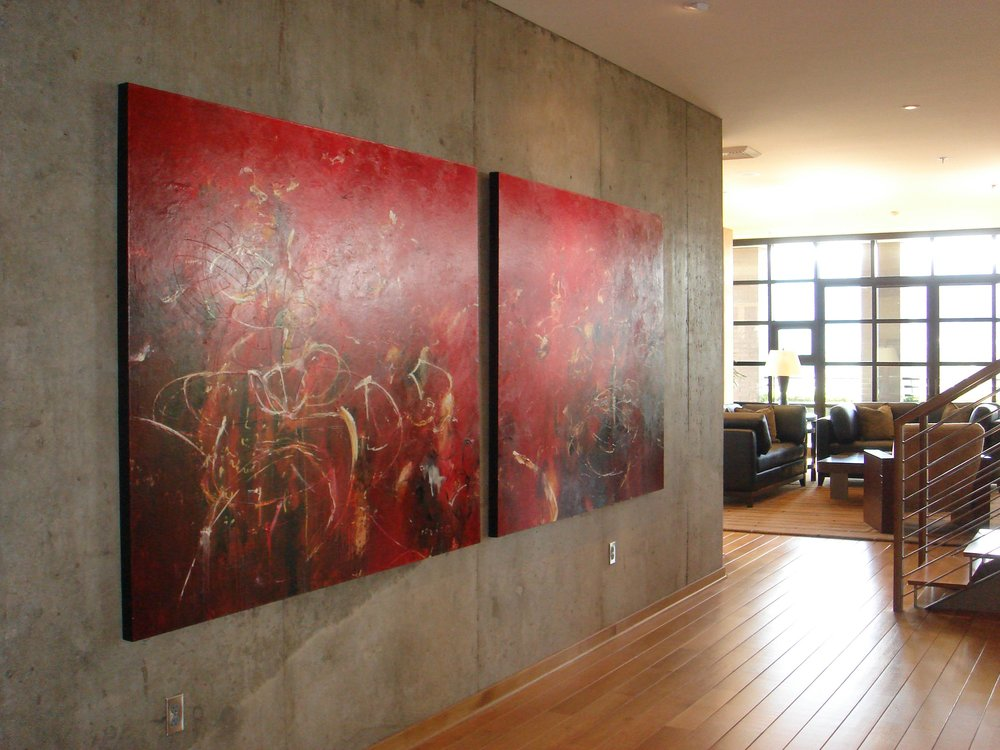 Home interior with hardwood floor and artwork on wall