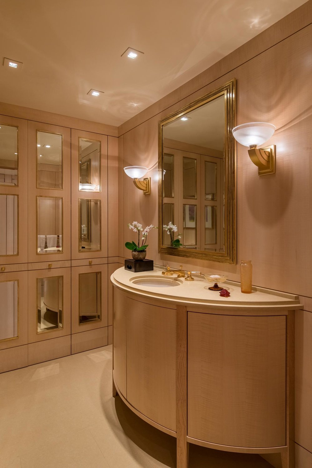 Bathroom interior with cabinet, countertop and mirror on wall