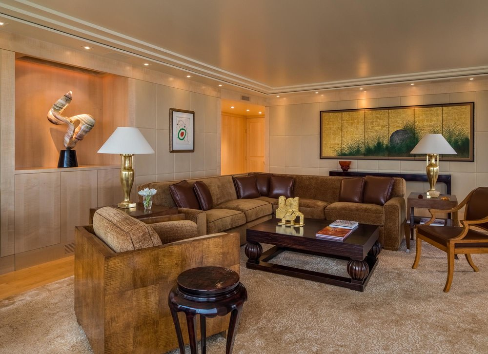 Modern living room with big sofa, wooden center table and carpet
