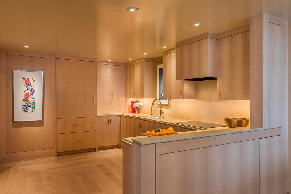 Kitchen with wooden details and exhaust hood