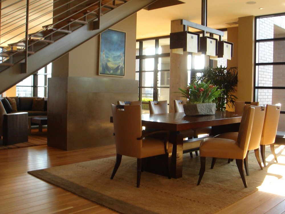 Dining room with table and chairs and carpet in a hardwood floor
