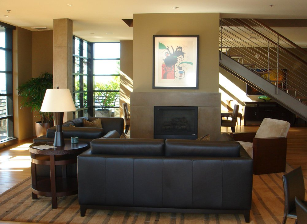 Living room with comfortable sofa and rounded table near and a fireplace