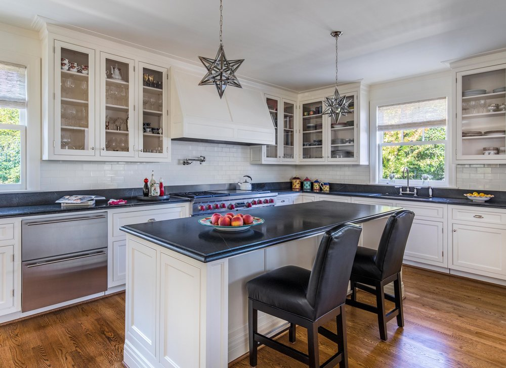 Modern dining room with hardwood floor, wooden center island, countertop and cabinet