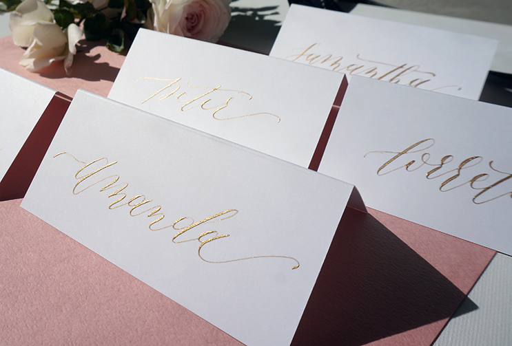 Gold, pointed pen calligraphy place cards