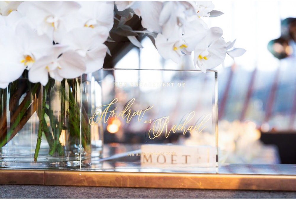 self standing clear acrylic signage with gold calligraphy