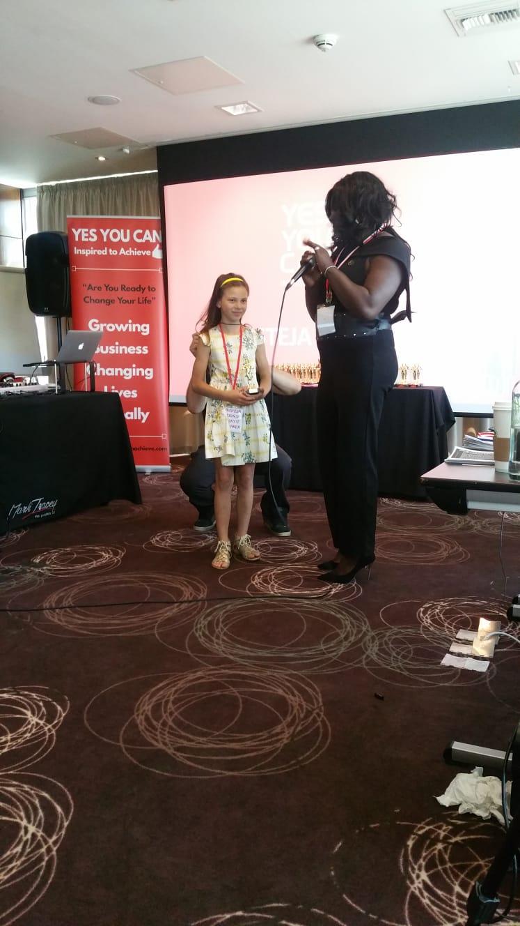 Sabrina Ben Salmi presenting Austeja with her Speakers Award