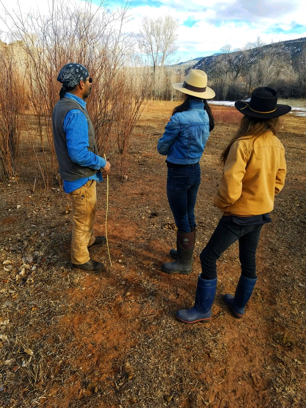 Florencio, Adelma, and Amy Discussing Field Restoration, 2019.
