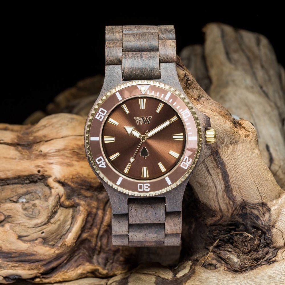 WEWOOD - DATE CHOCO ROUGH BROWN WOODEN WATCHWeWOOD create an eco-friendly, fashionable line of all-natural wooden watches from reclaimed and recycled wood and materials. The first company to create wrist watches from wood, completely free of toxic and artificial materials using exotic remnant hardwoods from around the world.HOW THEY GIVE BACKWeWOOD collaborates with Trees For The Future to plant 1 tree for every watch purchased.They are aiming to plant 1 million trees by 2020.CLICK HERE TO VIEW MORE