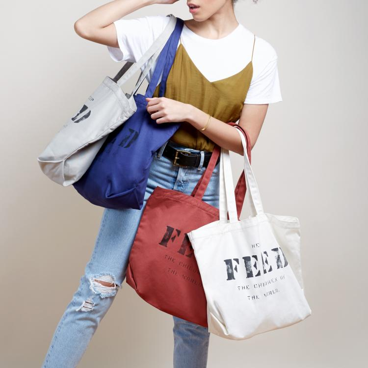 Feed - FEED TOTEFEED produce a wide range of bags alongside a few other choice items. They are a social business who believe in the principle that people's choices of what to buy and wear have the power to change the world. All of their products are produced under fair-labour conditions. They also use environmentally-friendly materials, including organic cotton and burlap, whenever possible.HOW THEY GIVE BACKThey work with established cooperatives in Colombia, Guatemala, Haiti, India, Kenya, El Salvador, and Peru to provide sustainable livelihoods to underserved populations.Every purchase provides meals in the countries where they were produced. Every product has a number stamped on it that signifies the amount of meals or micronutrient packets provided with its purchase.CLICK HERE TO VISIT SITE