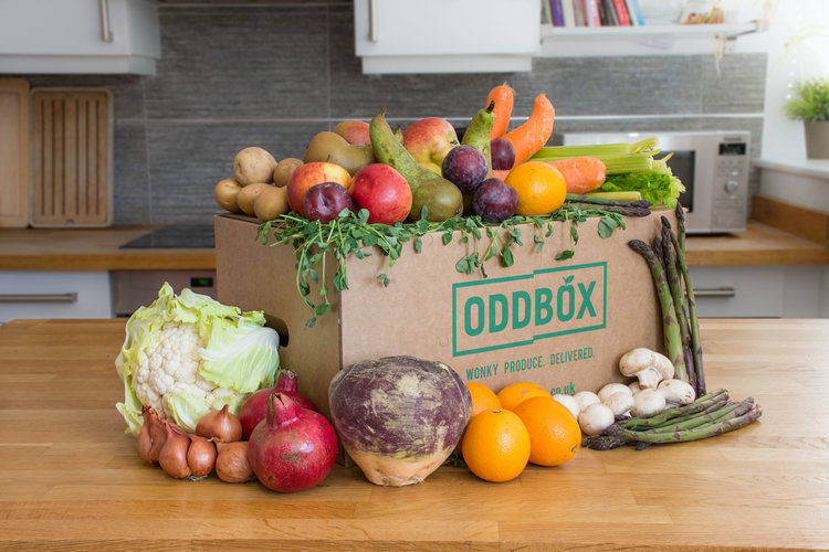 OddBox - PRICE RANGE- £8.99 to 17.25 Home box/£14.99 Work boxDELIVERY - Free to London/Greater London areas.PACKAGING-delivered in cardboard boxes which are then reused or recycled. All extra packaging is 100% recyclable or degradable (unless already packaged for supermarkets by their suppliers).ALSO- They buy 'odd' produce from local growers & markets at a fair price. They always try to put local growers at the forefront of everything they do. At certain times of the year there's a limited availability of produce, and certain fruit varieties don't grow in the UK at all, so produce may be sourced from abroad to provide you with an interesting and healthy selection in your boxes, they might not necessarily be misshapen but in most cases are surplus as a result of over ordering from the supermarkets.Oddbox partner with local charities to donate up to 10% of their produce to charity and help feed those in need.