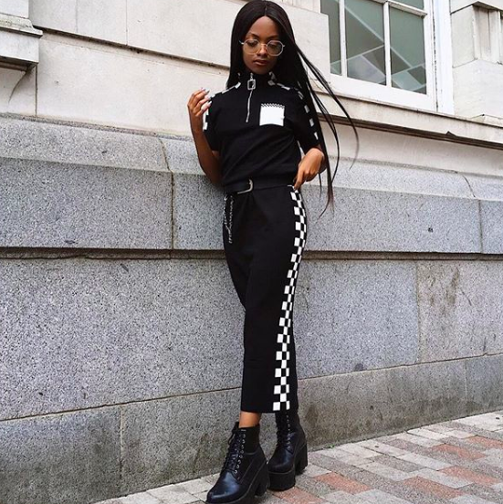 @mpholebajoa wearing our racer two piece
