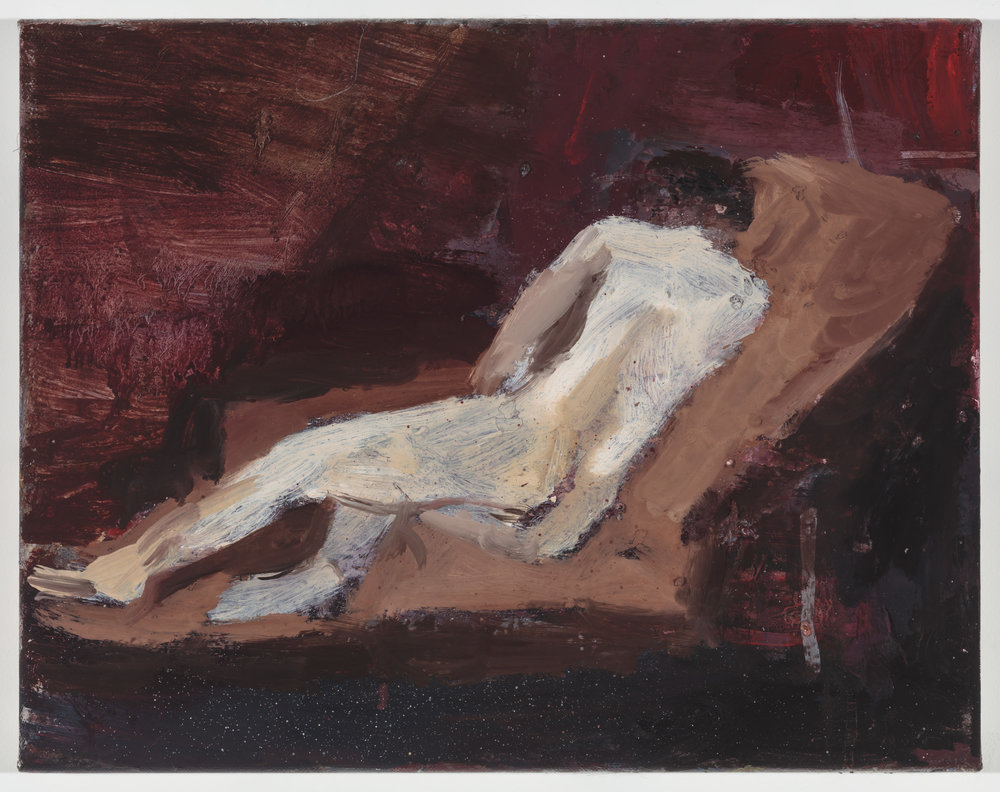 Woman reclining on a Couch