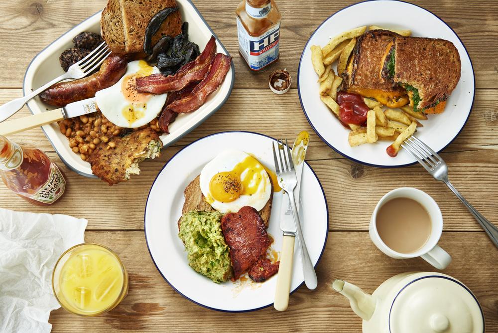 food-photographer-london-photography-drinks-director-table-top-tabletop-advertising-editorial-packaging-pr-foodporn-honest-burgers-burger-brunch-breakfast-full-english-breakfast-table-scene-above-toastie-bacon-sausages-chorizo-juice-overhead.jpeg