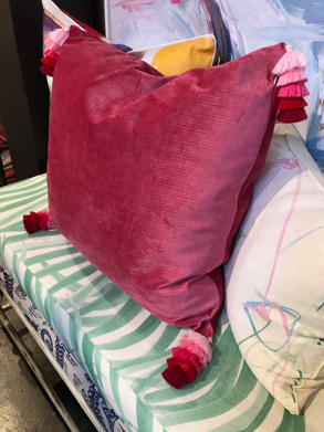 This beautiful pillow at  Design Legacy  with very special graduated pink tassel trim on the corners.