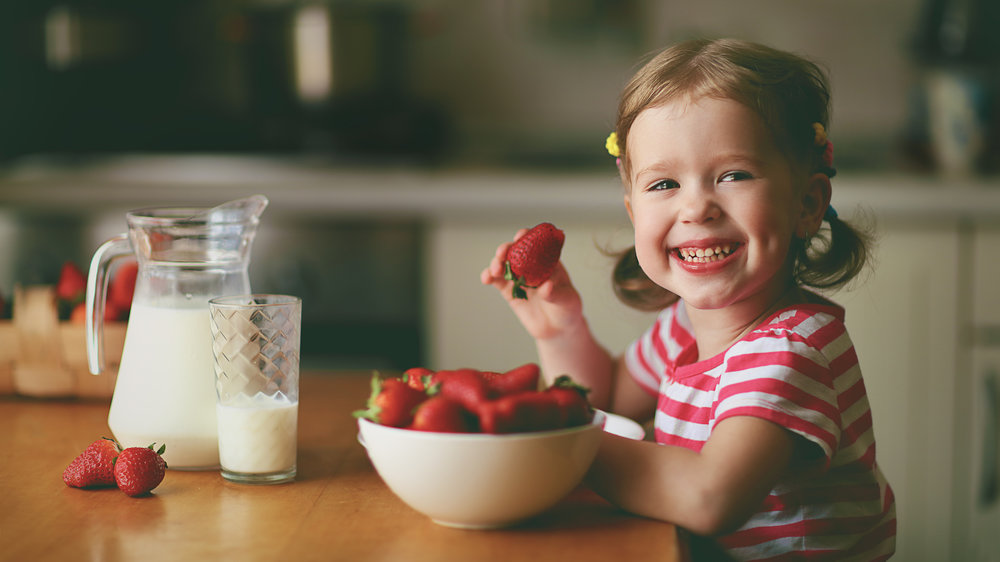 Feeding Therapy - Young Girl eating Strawberries