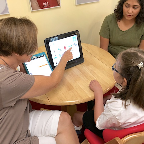 Augmentative Communication (AAC) Therapy with Lynn Carswell and Little Girl