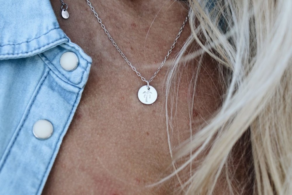 Mini Disc Necklace    – I love how silver looks against sun kissed skin! This mini disc necklace has a choice of 8 different stamps. Go with the palm tree or wave for that Summer vibe.