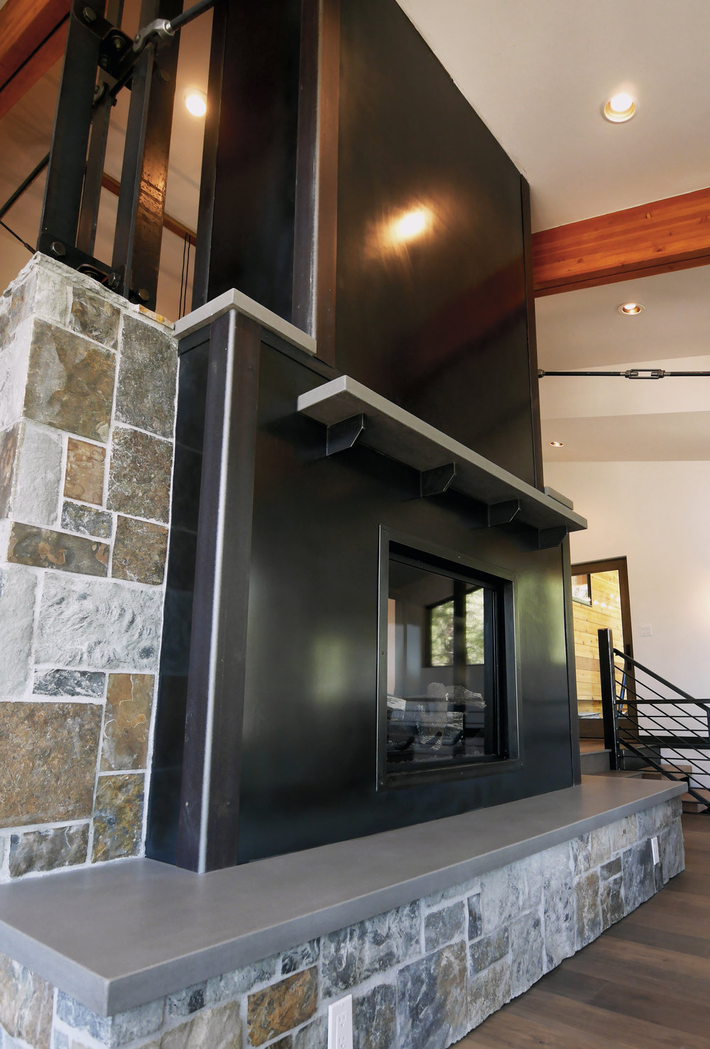 Steel Panel Fireplace with Floating Concrete Mantle and Hearth.jpg
