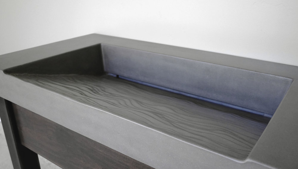 Topo Textured Concrete Ramp Sink.jpg