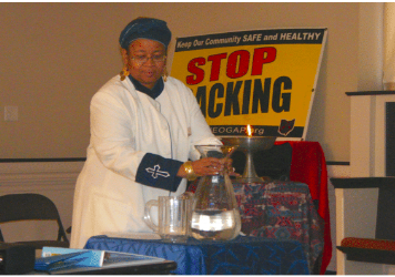 Rev. Monica Beasley-Martin conducting a blessing of Ohio waters at a FaCT meeting