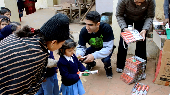 THEN: UTR donates school supplies to over 1000 children living and studying in the slums of Delhi