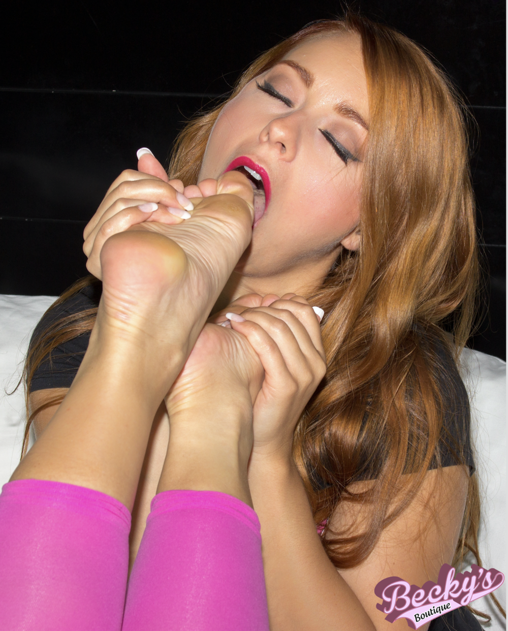 Becky samples Sindy's toes.beckysboutique.nyc.png