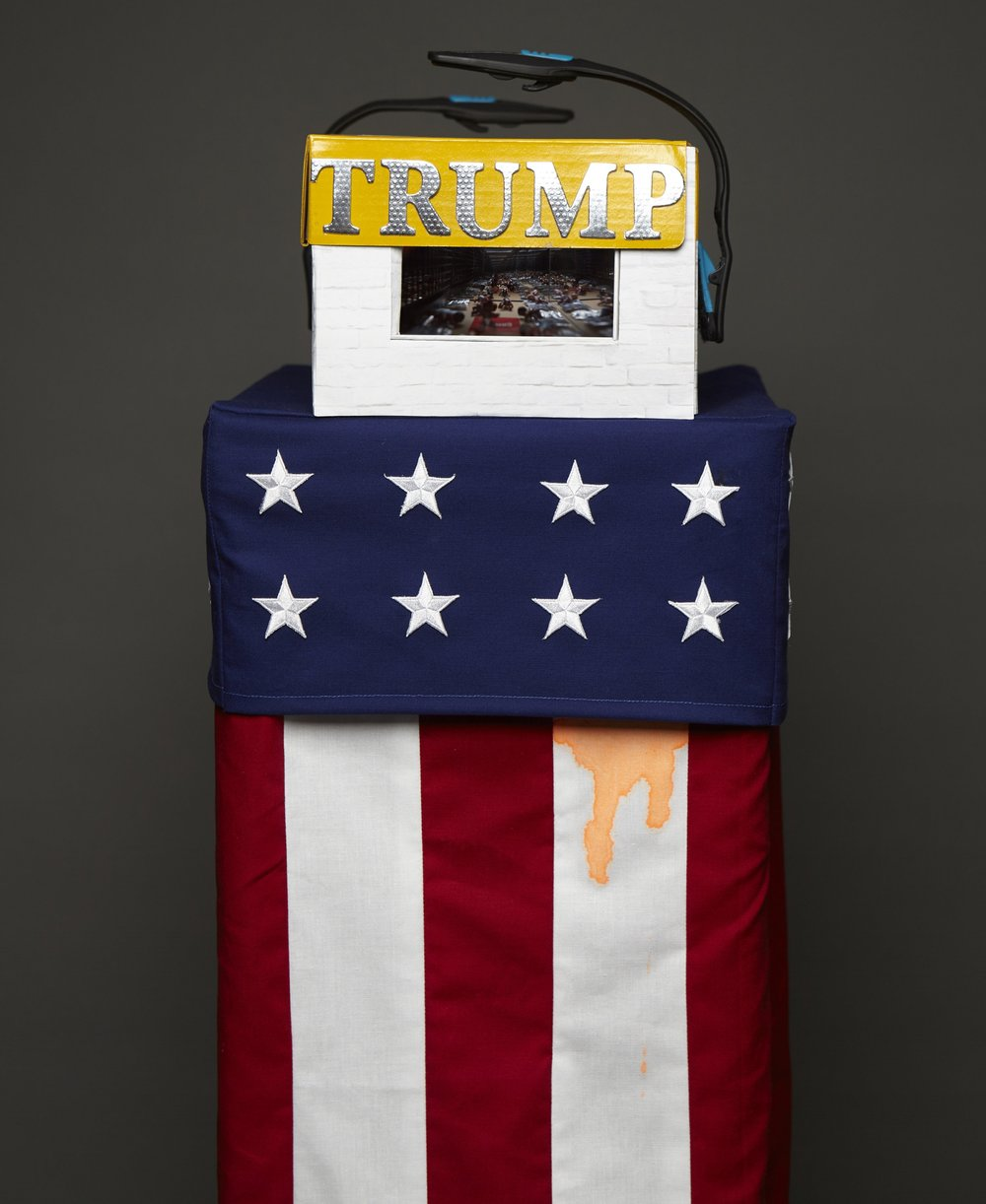 "Trump Camp for Immigrants   -smoke and mirrors 12""x53""x12"""