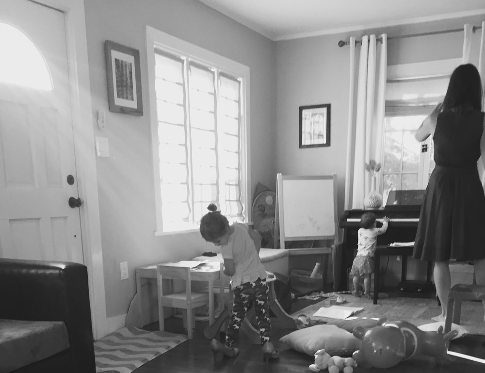 I'm dressed, but sans heels, because Annabel's trying them on with her unicorn pajamas. Leila's at the piano, helping me with my low notes apparently. Miscellaneous toys strewn about simulate any distraction that may come about during a performance.