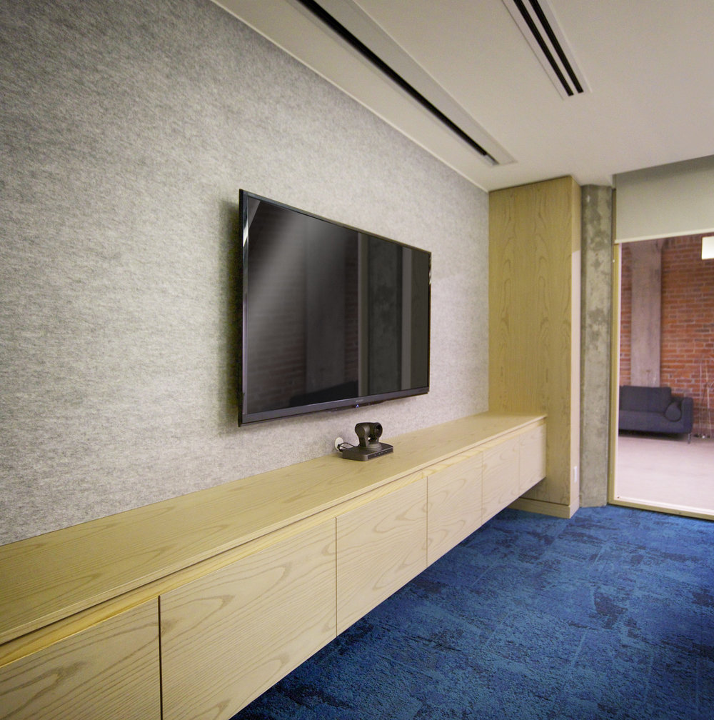 Clean, concealed cabling and bare surrounding surfaces help to enhance the feeling of fully physical integrated technology.