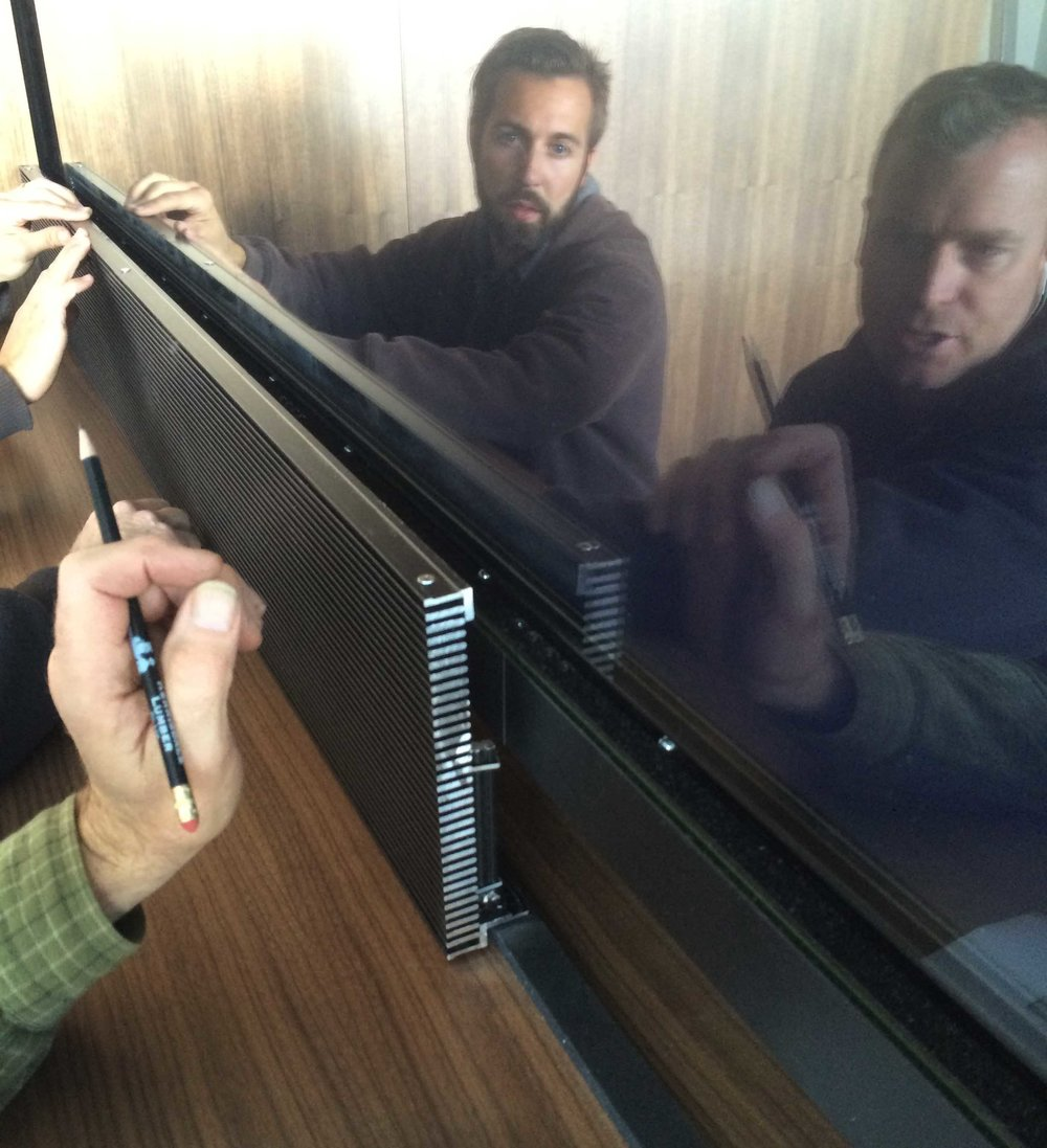 Installing custom-adapted vent grilles beneath the touchable glass that encases the six screens.