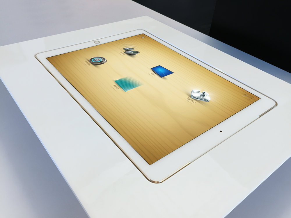 Shown before installation, this detail shot shows the tight fit and finish that we achieved between the iPad and the surrounding machined aluminum bezel. The white powder coating was a perfect match to the Apple© hardware.