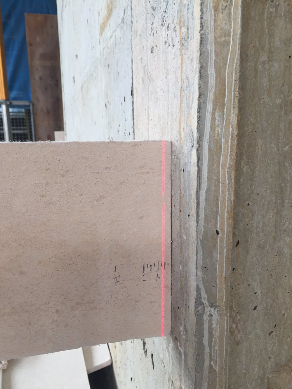Testing the depth of the existing concrete sub wall.