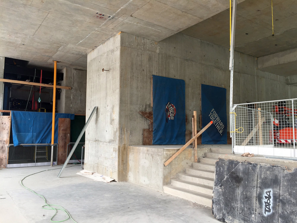 The space at the beginning of the project was a rough, concrete environment.