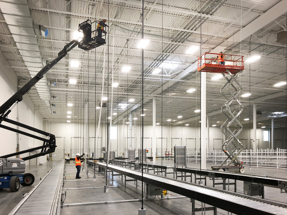 Scissor and boom lifts were constantly used during the first months of the project, particularly before the shelving had been completed.