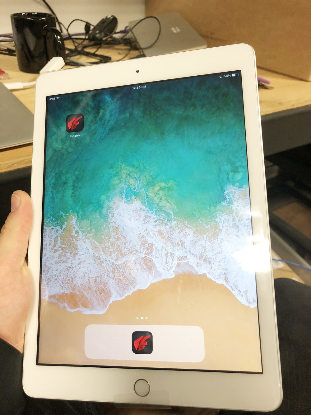 An iPad, that forms the control touchpoint of our room systems, is configured in staging. Here, you can see the Kutano app installed on the iPad.