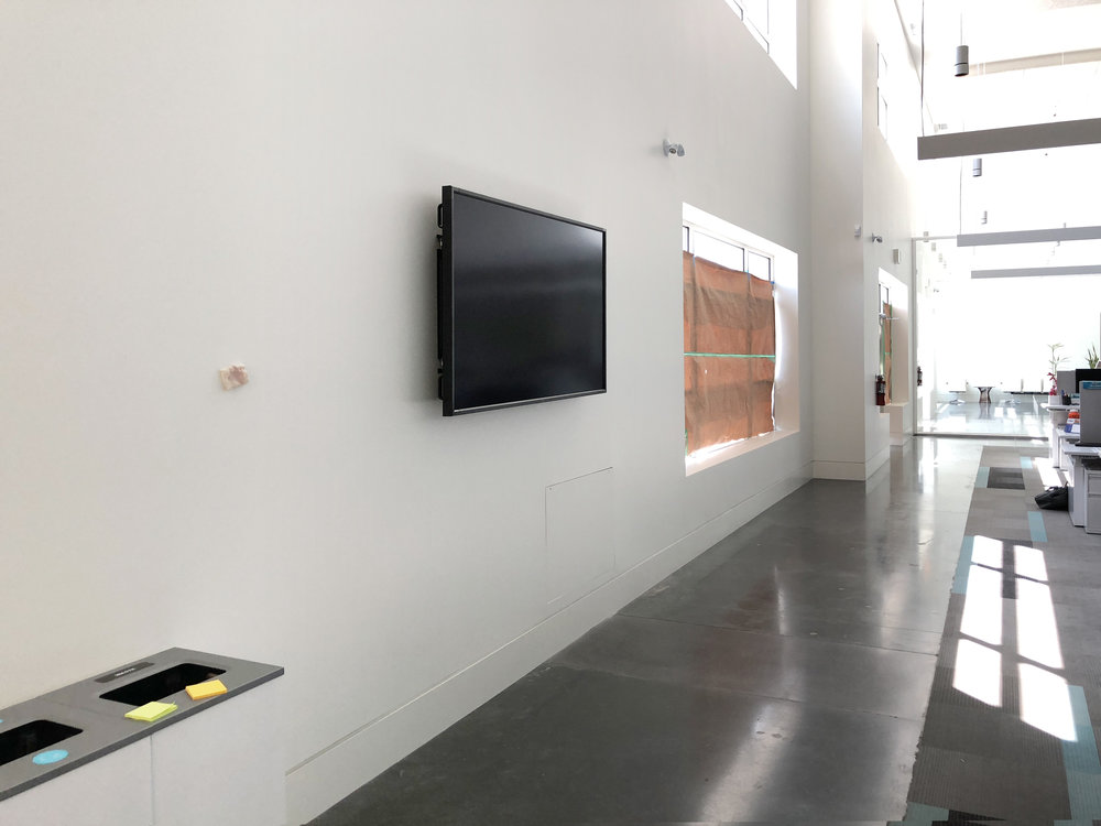 Prior to final construction cleaning, this TV sits on a wall quietly, awaiting its first use.