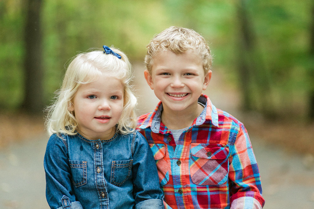 Two adorable children smiling at the camera
