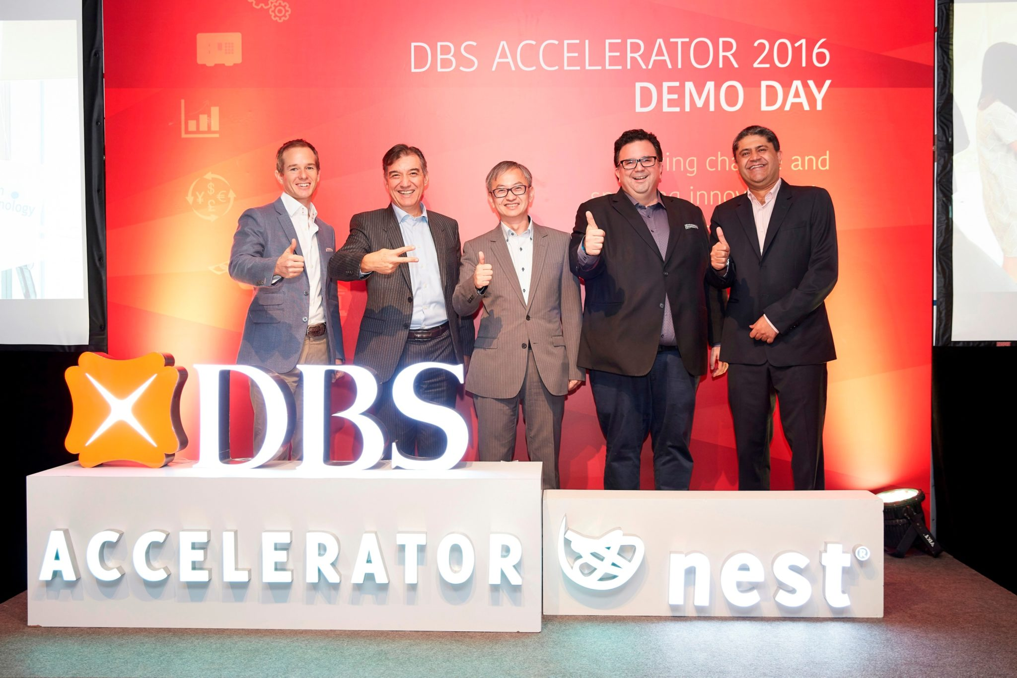 (from left to right) Lawrence Morgan, CEO of Nest, Sebastian Paredes, DBS Bank (Hong Kong) CEO, Under Secretary for Innovation and Technology Dr David Chung, Will Ross, Partner and Head of Nest Innovation at Nest, and Nimish Panchmatia, DBS Bank (Hong Kong)'s Managing Director and Head of Technology & Operations, Hong Kong & Mainland China, officiate at DBS Accelerator 2016 Demo Day.