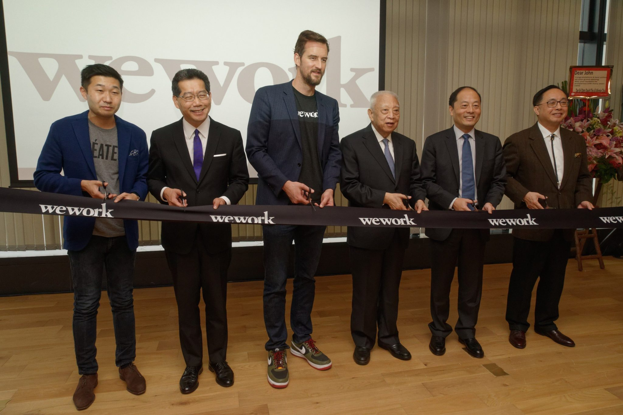 (From Left to Right) Mr. Ole Ruch, Managing Director for Strategy, Asia and Australia of WeWork; Mr. Gregory So, Secretary for Commerce and Economic Development of the HKSAR Government; Mr. Miguel McKelvey, Co-founder and Chief Creative Officer of WeWork; The Honourable Tung Chee-hwa, Vice Chairman of the 12th National Committee of Chinese People's Political Consultative Conference; Mr. John Zhao, Executive Vice President of Legend Holdings and Chairman and CEO of Hony Capital; and Mr. Nicholas Yang, Secretary for Innovation and Technology of the HKSAR Government, officiating at the Opening Ceremony of WeWork Hong Kong.