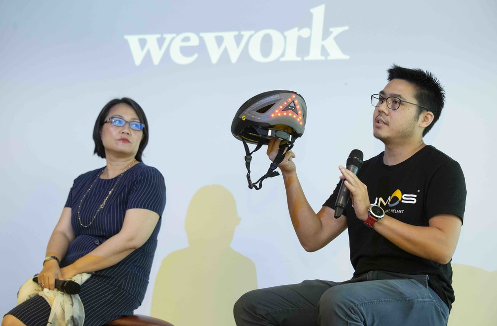 WeWork members Vicky Wu, Founder of NBI Solutions (left) and Zhan Tang, Business Manager at Lumos Helmet (right), share how the new WeWork Two Harbour Square and its global resources will be beneficial to their businesses.