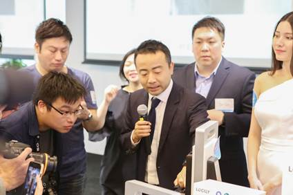Mr. Lee Zheng, Founder and CEO of Lockly™ demonstrates the features of the Lockly™ Secure Smart Lock series for reporters.